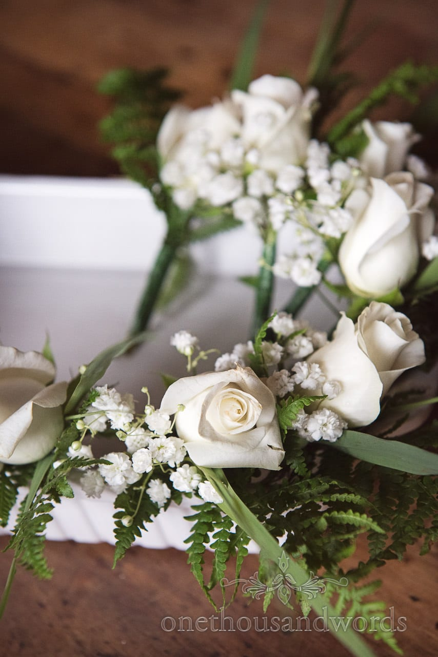 White rose groomsmen buttonholes from Dorset garden wedding