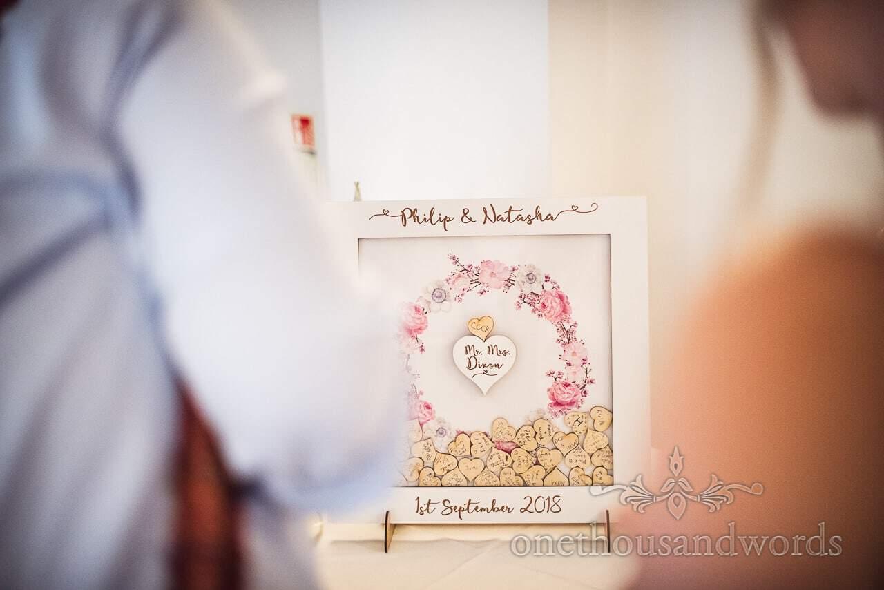 Wooden heart filled guest messages from Italian Villa Wedding