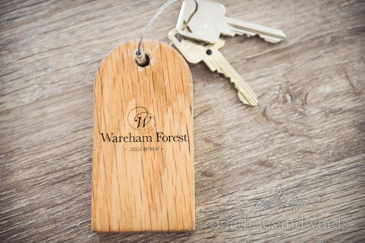 Wooden lodge key fob before Italian Villa Wedding