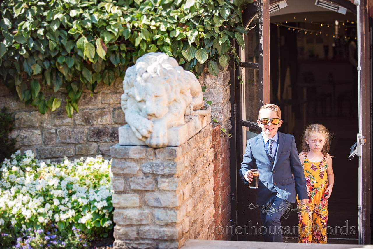 Young guest looking cool at wedding at the Italian Villa