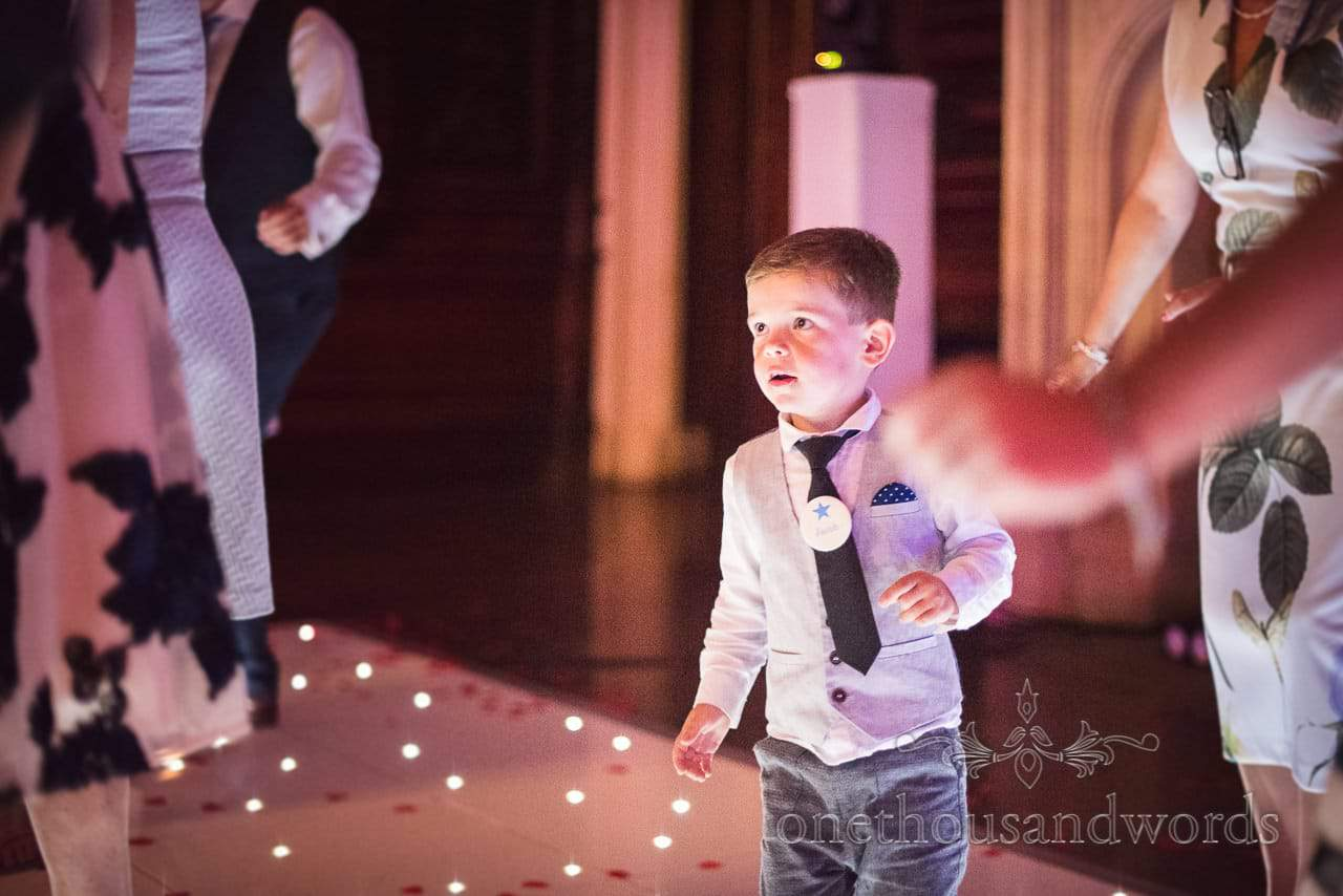 Young wedding guest on dance floor during evening reception