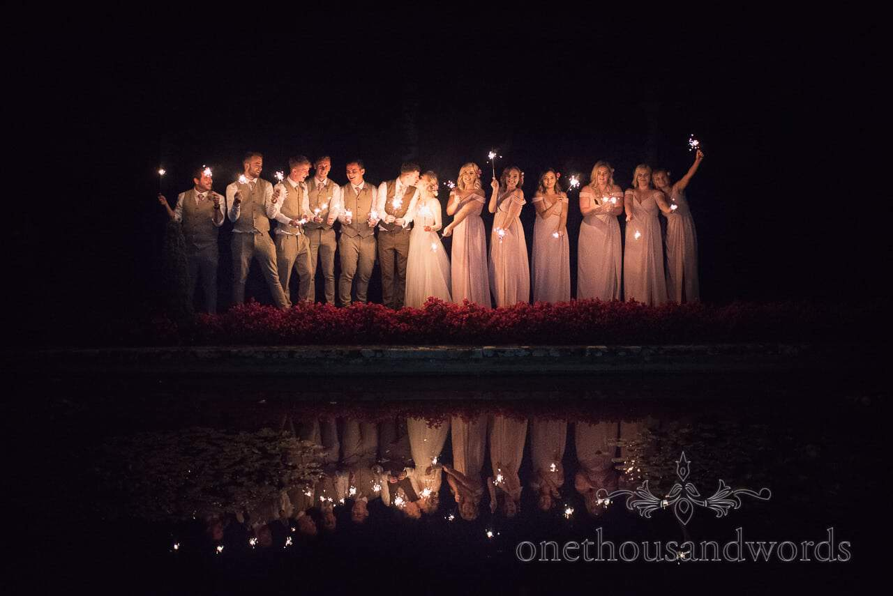 Italian Villa Documentary Wedding Photos of wedding party with sparklers reflected in lake