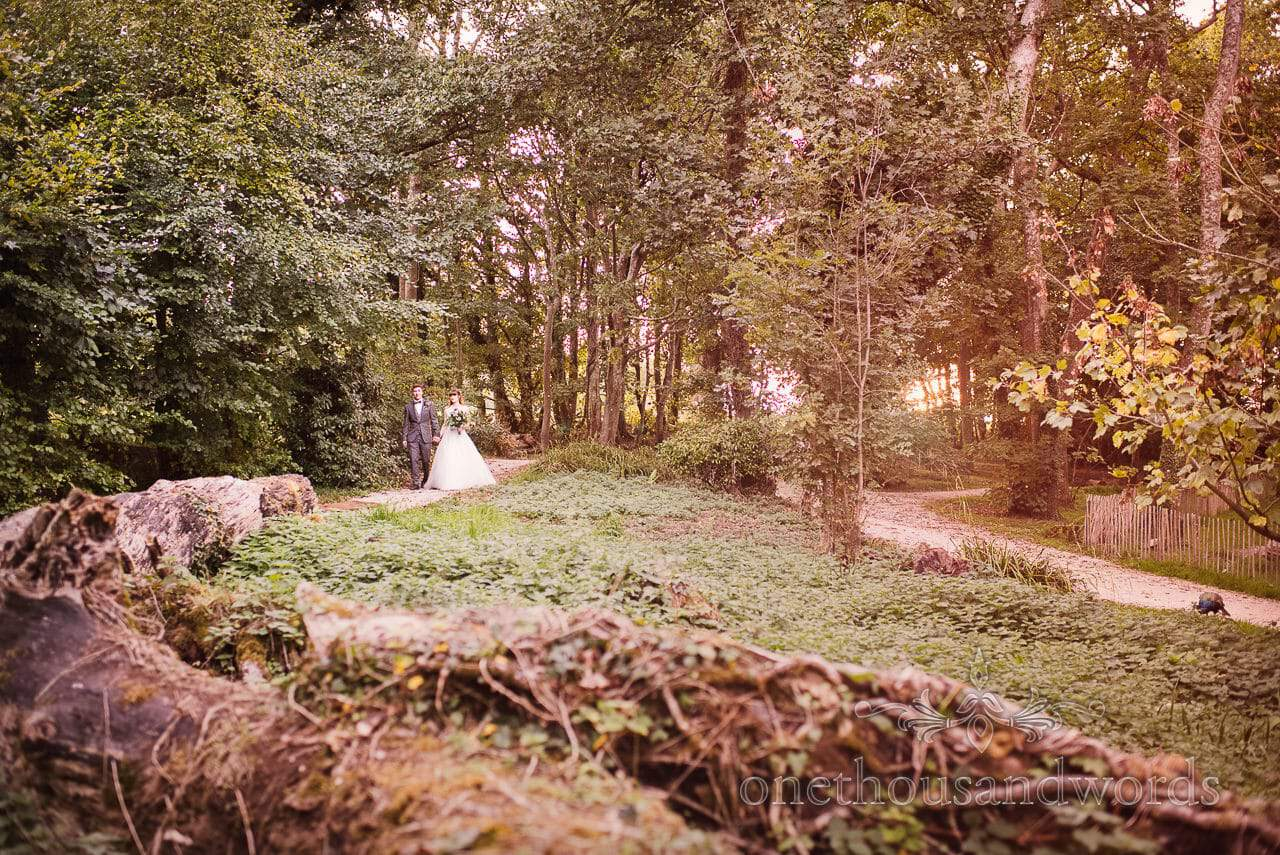 Woodland Lulworth Castle Wedding Photos of bride and groom at sunset