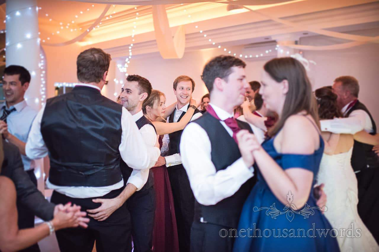 Best man and bridesmaid on wedding dance floor at Hethfelton House
