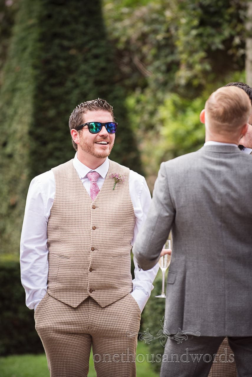 Best man dons sunglasses in garden at Italian Villa wedding