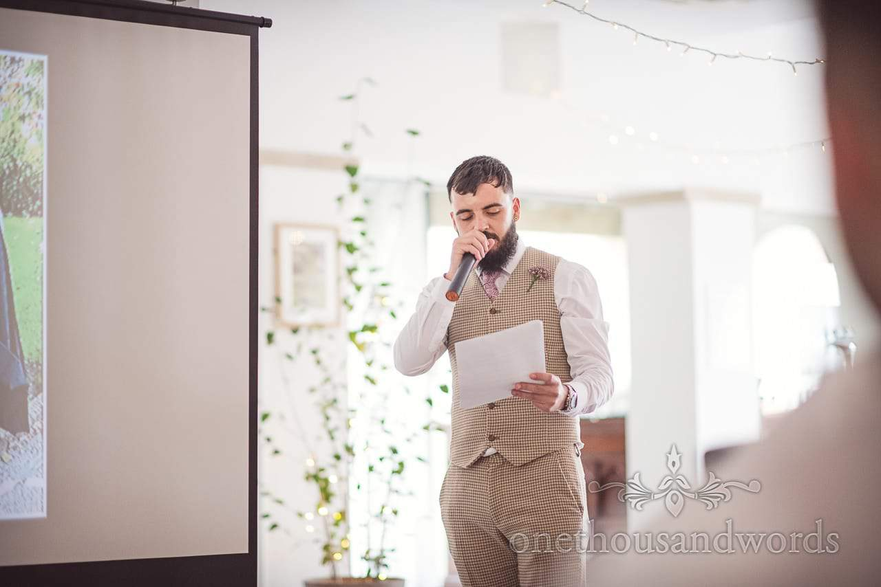 Best man in matching trousers and waistcoat during speech at Italian Villa wedding
