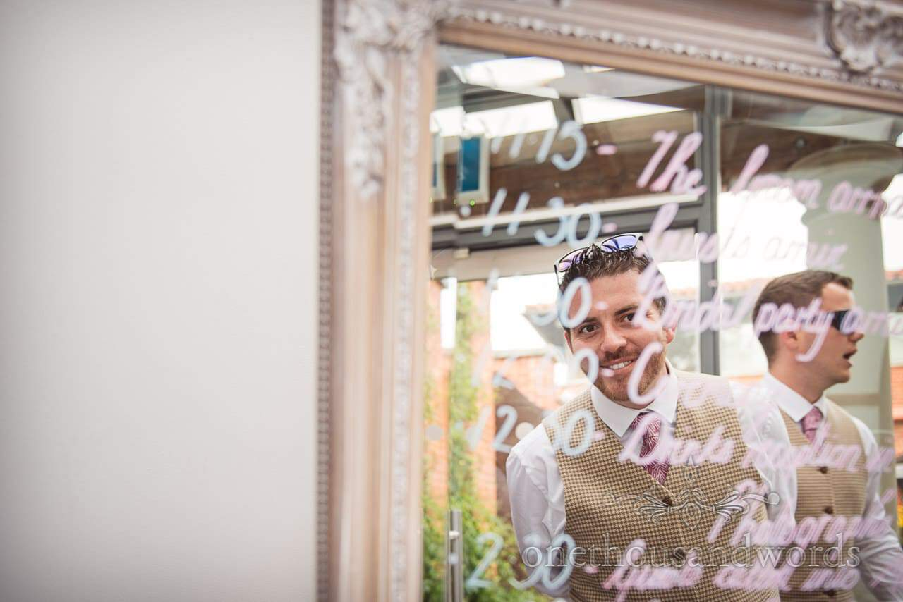 Best man reflection in mirror order of the day at Italian Villa wedding