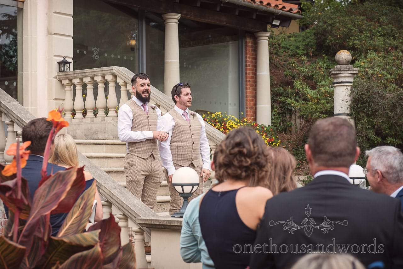 Best men announce that the bride will be arriving shortly at Italian Villa documentary wedding Photos