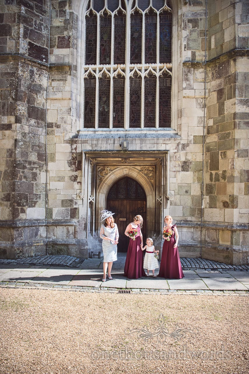 Bridal party await bride outside Wimborne Minster doorway