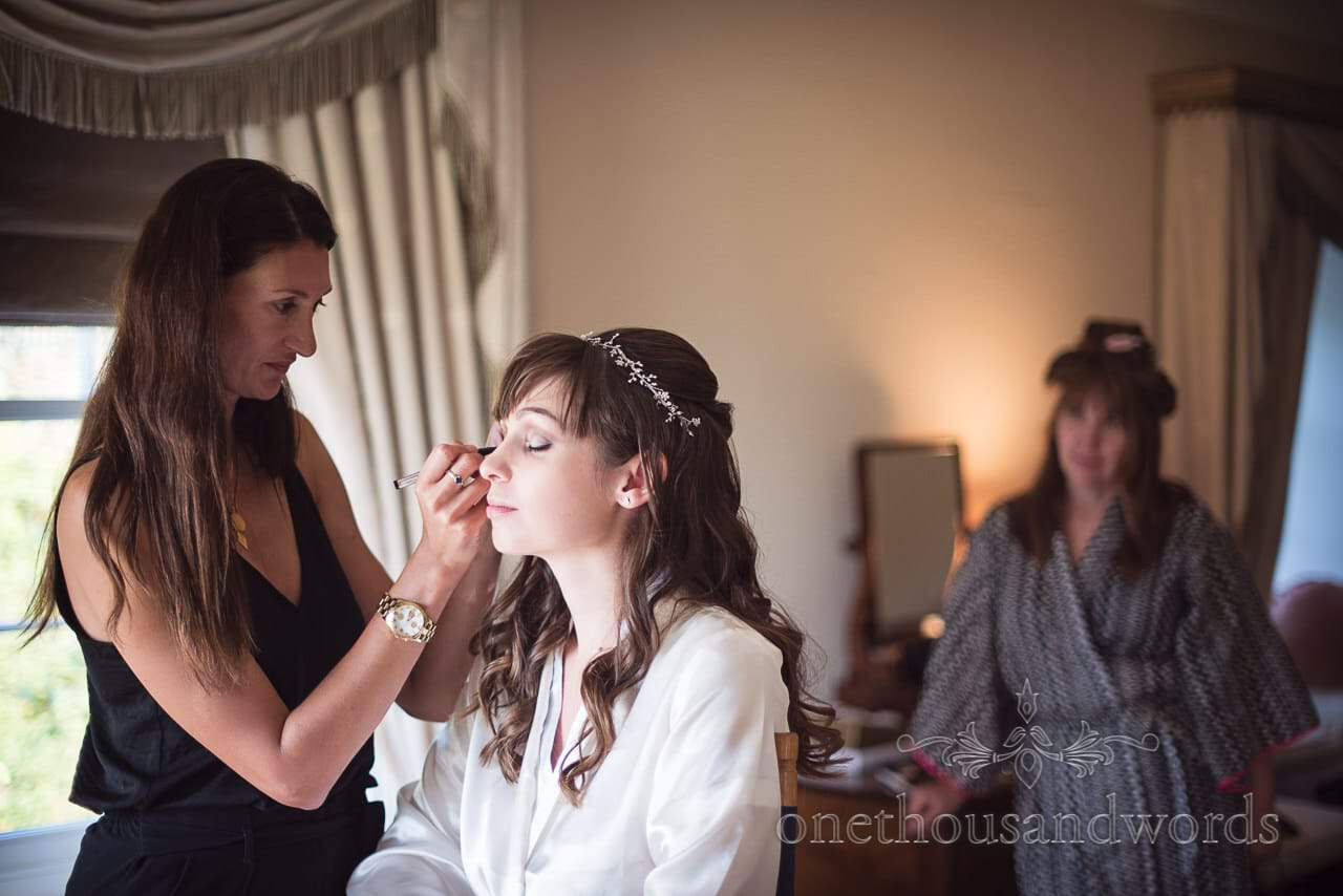 Bride has wedding make up styled watched by mother Hethfelton House