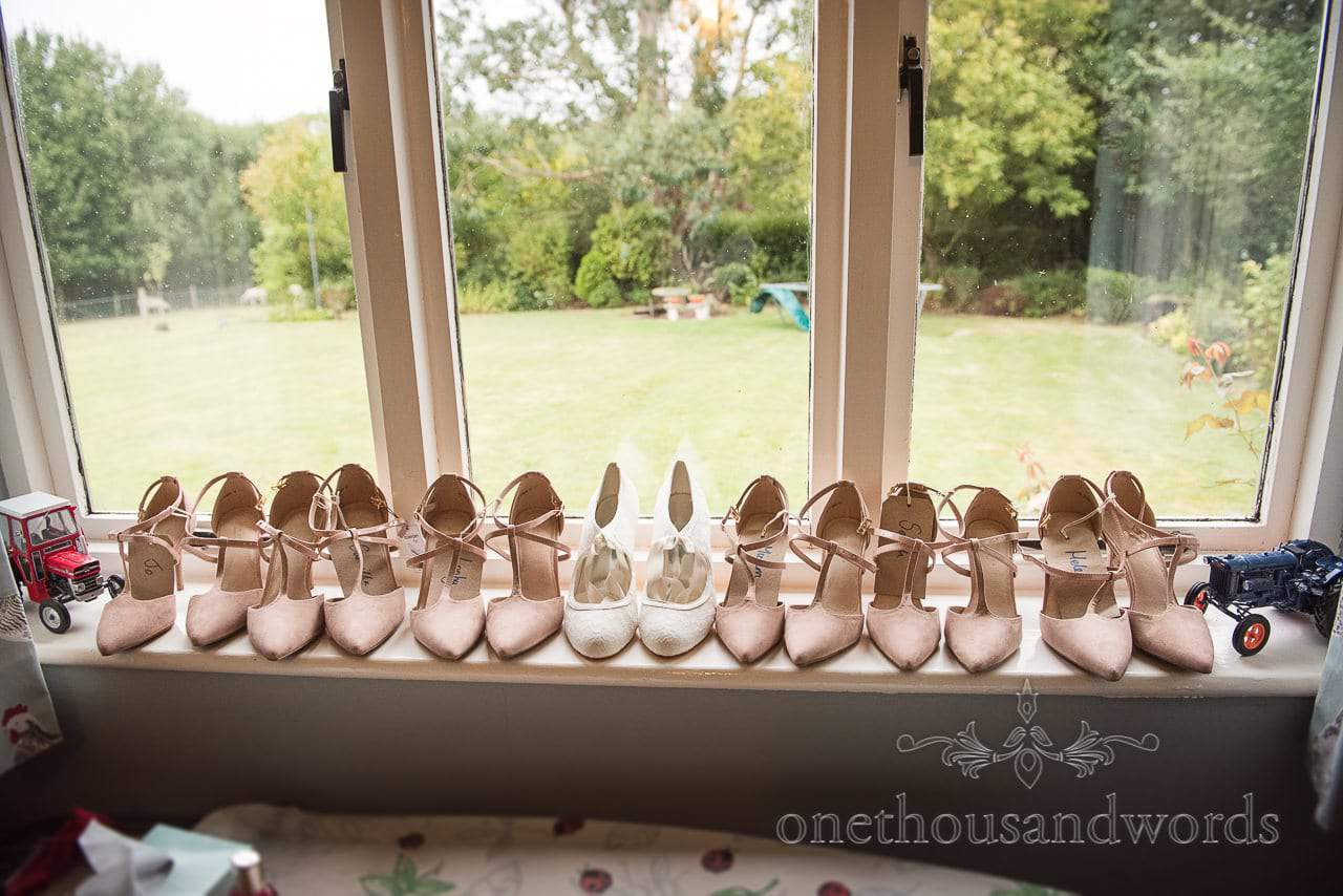 Bride and bridesmaid shoes all lined up on wedding morning