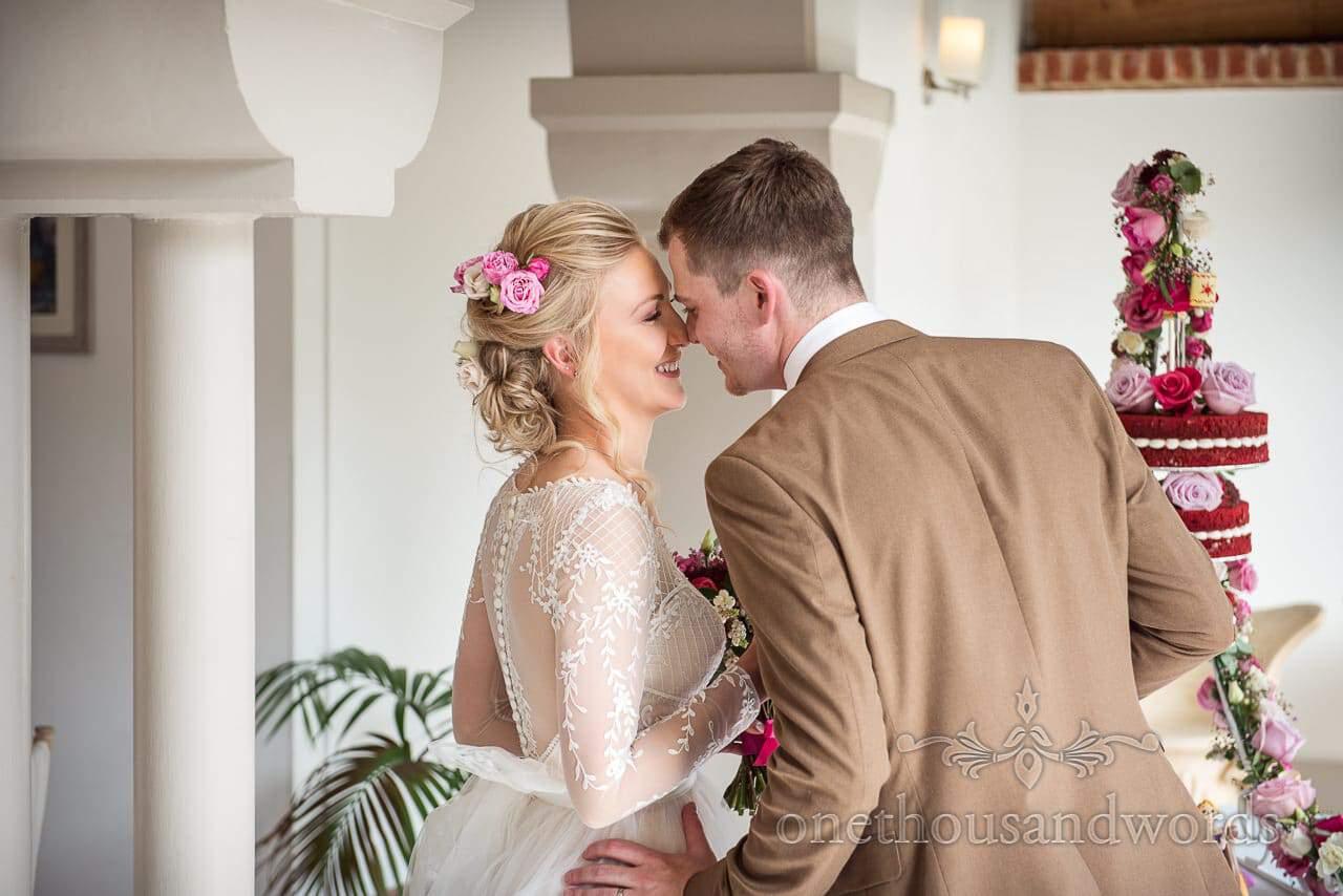 Bride and groom Eskimo kiss during Italian Villa wedding