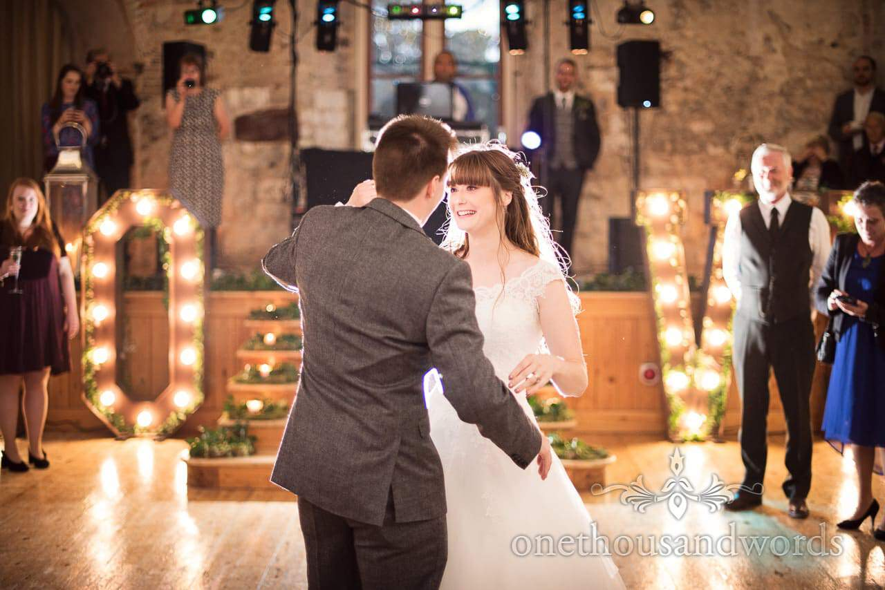 Bride and groom first dance with LOVE letters at Woodland Lulworth Castle Wedding