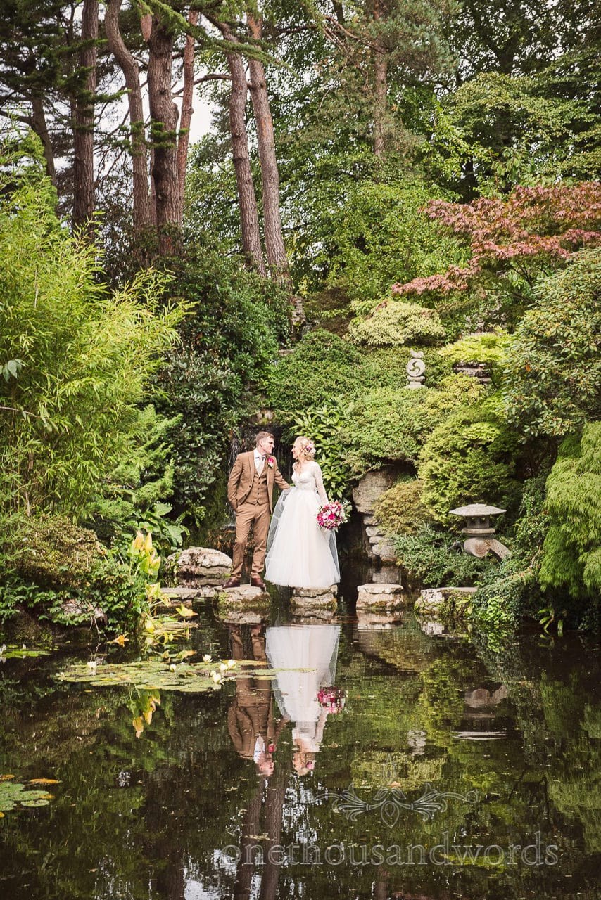 Bride and groom in Japanese gardens at Compton Acres