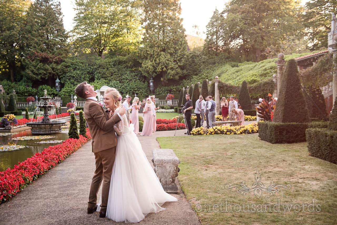 Bride and groom laughing in gardens at The Italian Villa wedding venue
