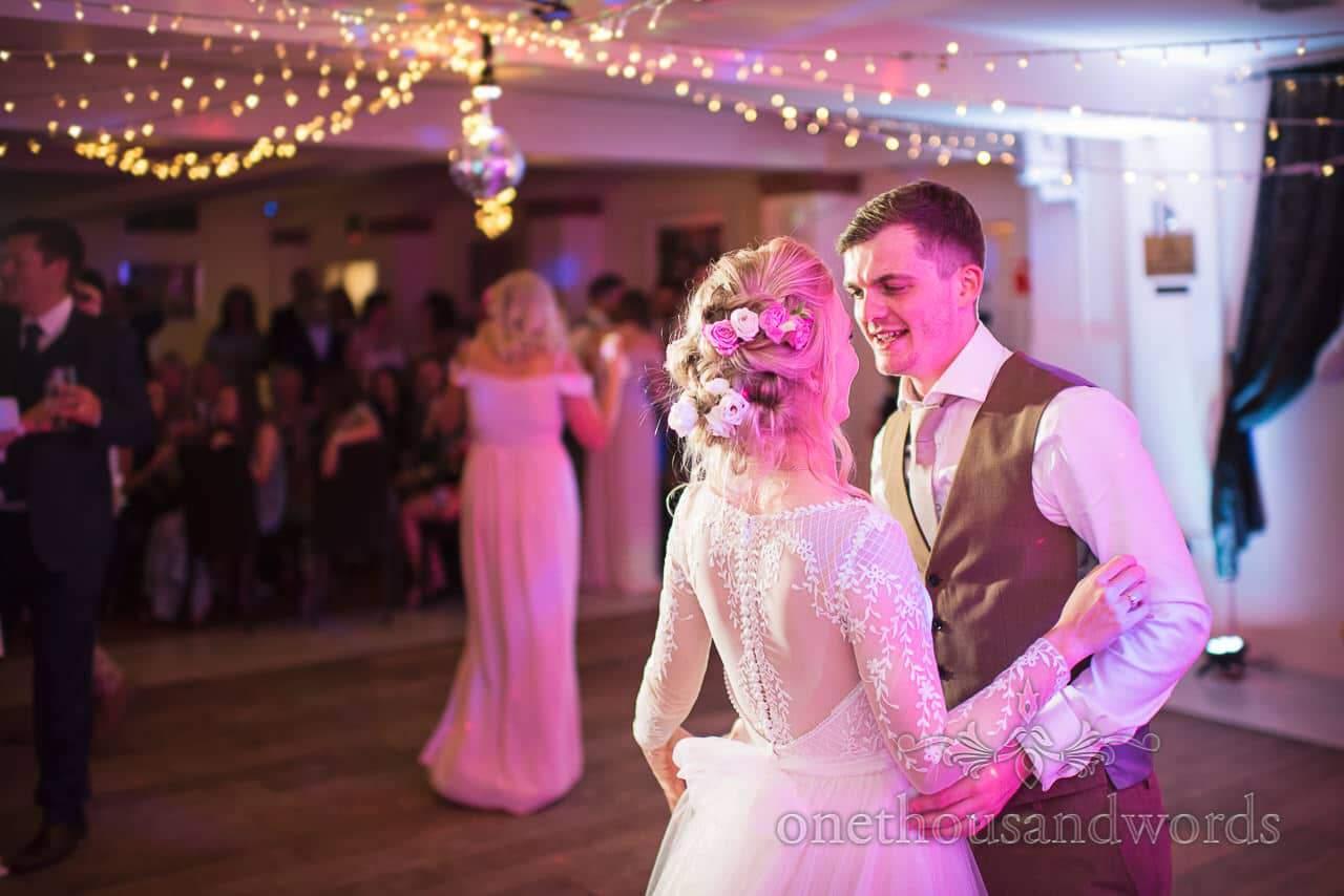Bride and groom on the dance floor disco lights at The Italian Villa Wedding