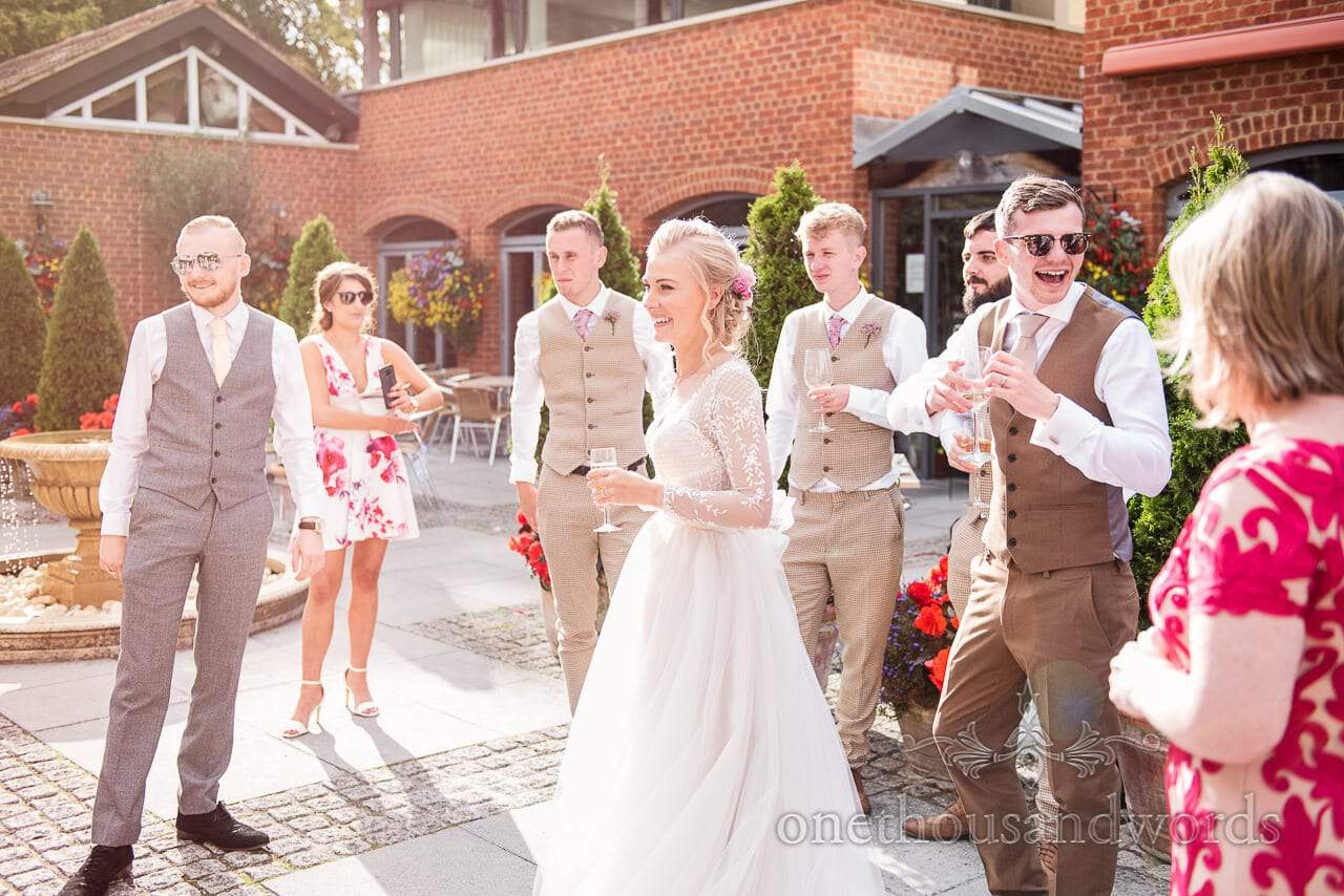 Bride and groom with friends in the courtyard at Italian Villa wedding