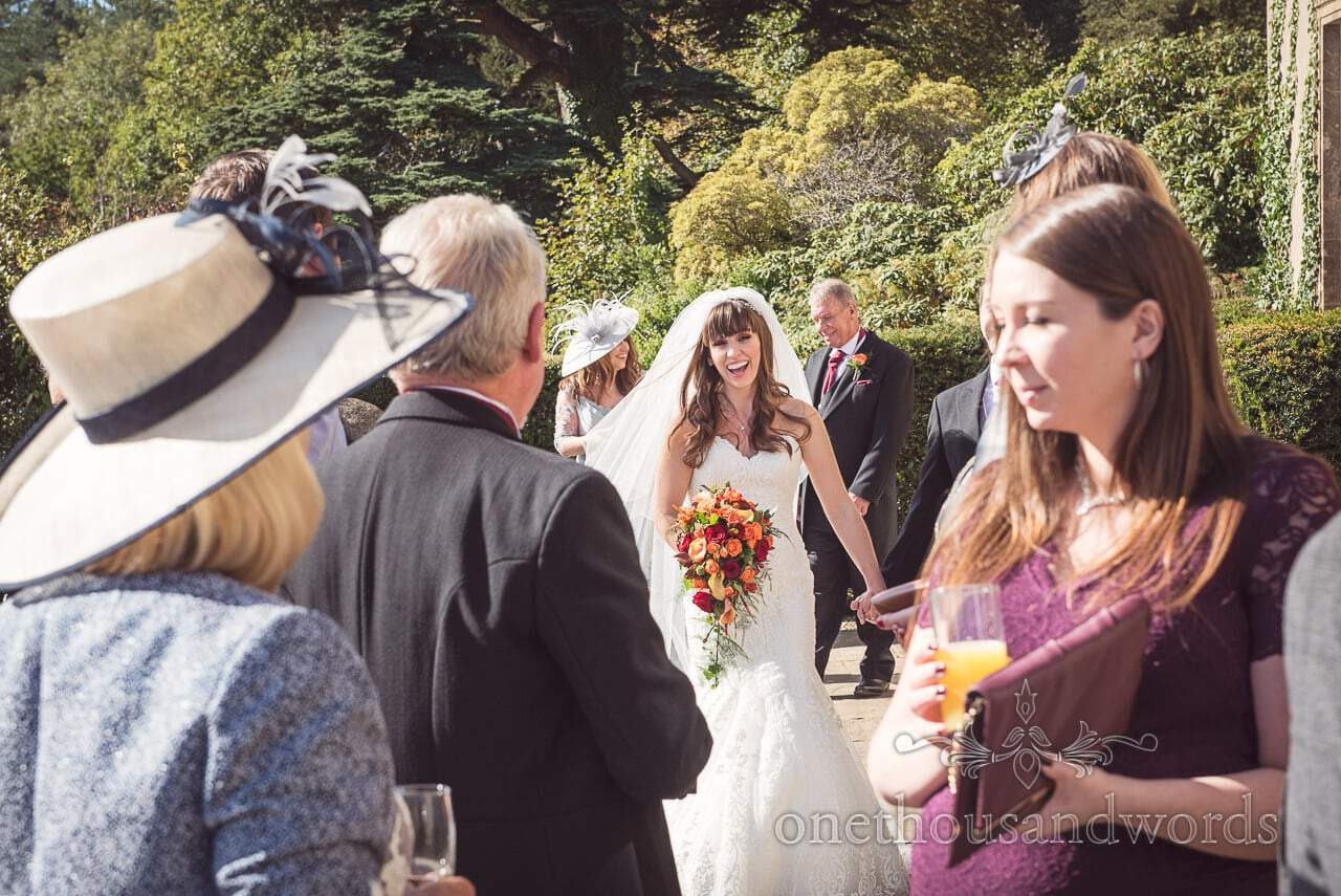 Bride arrives to see wedding guests at Hethfelton House reception