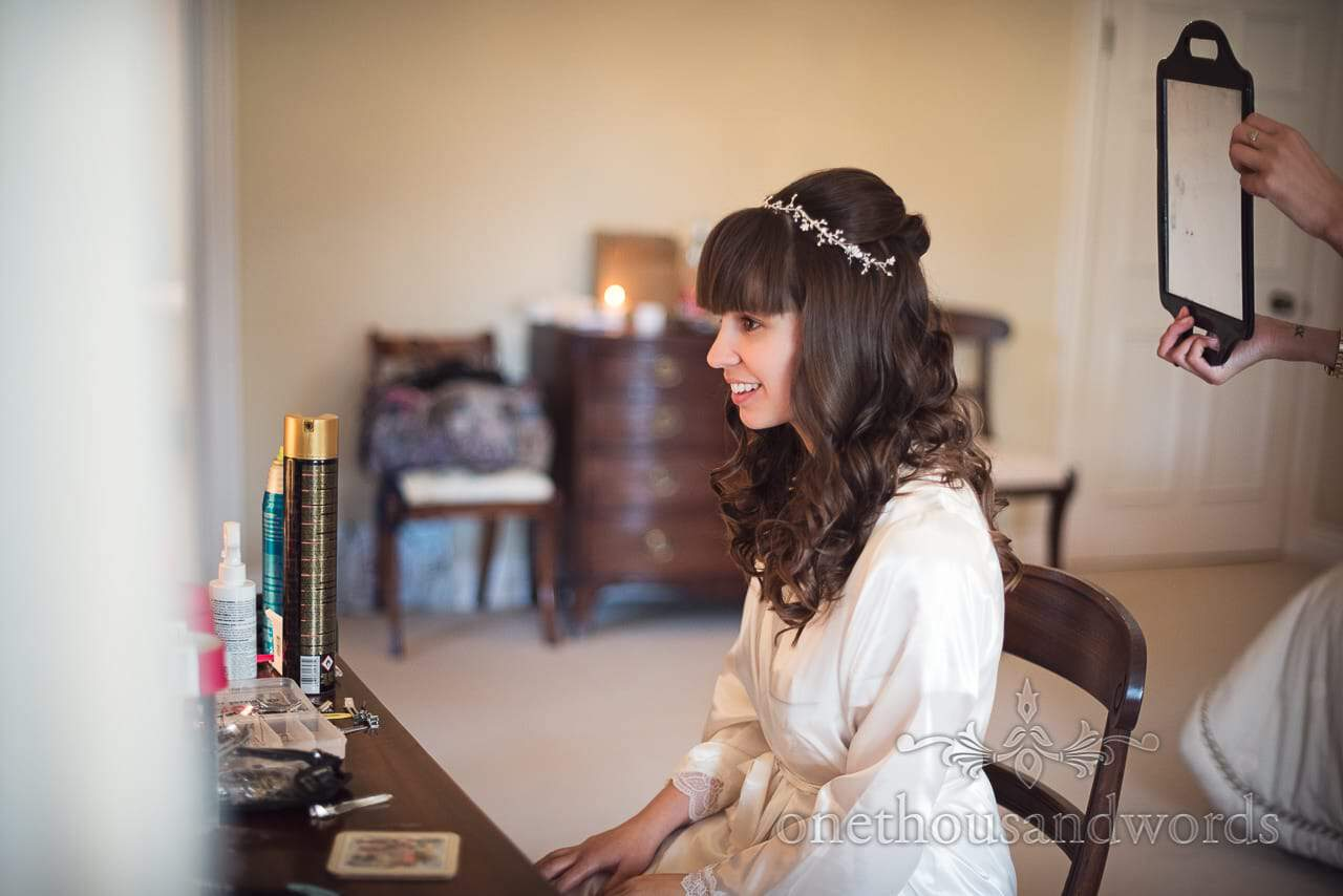 Bride checks wedding hair styling before Hethfelton House Wedding