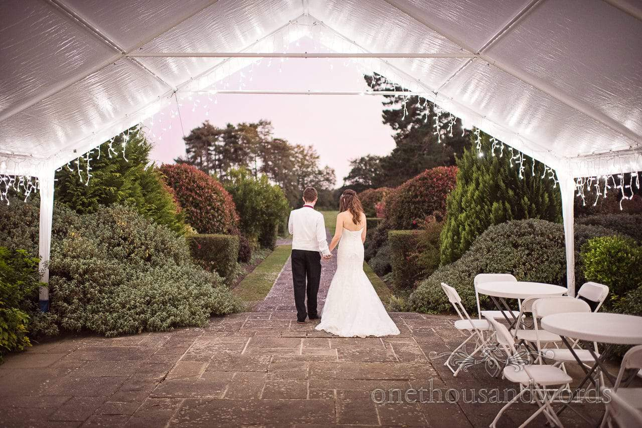 Bride and groom enjoy evening air at Hethfelton House Wedding venue