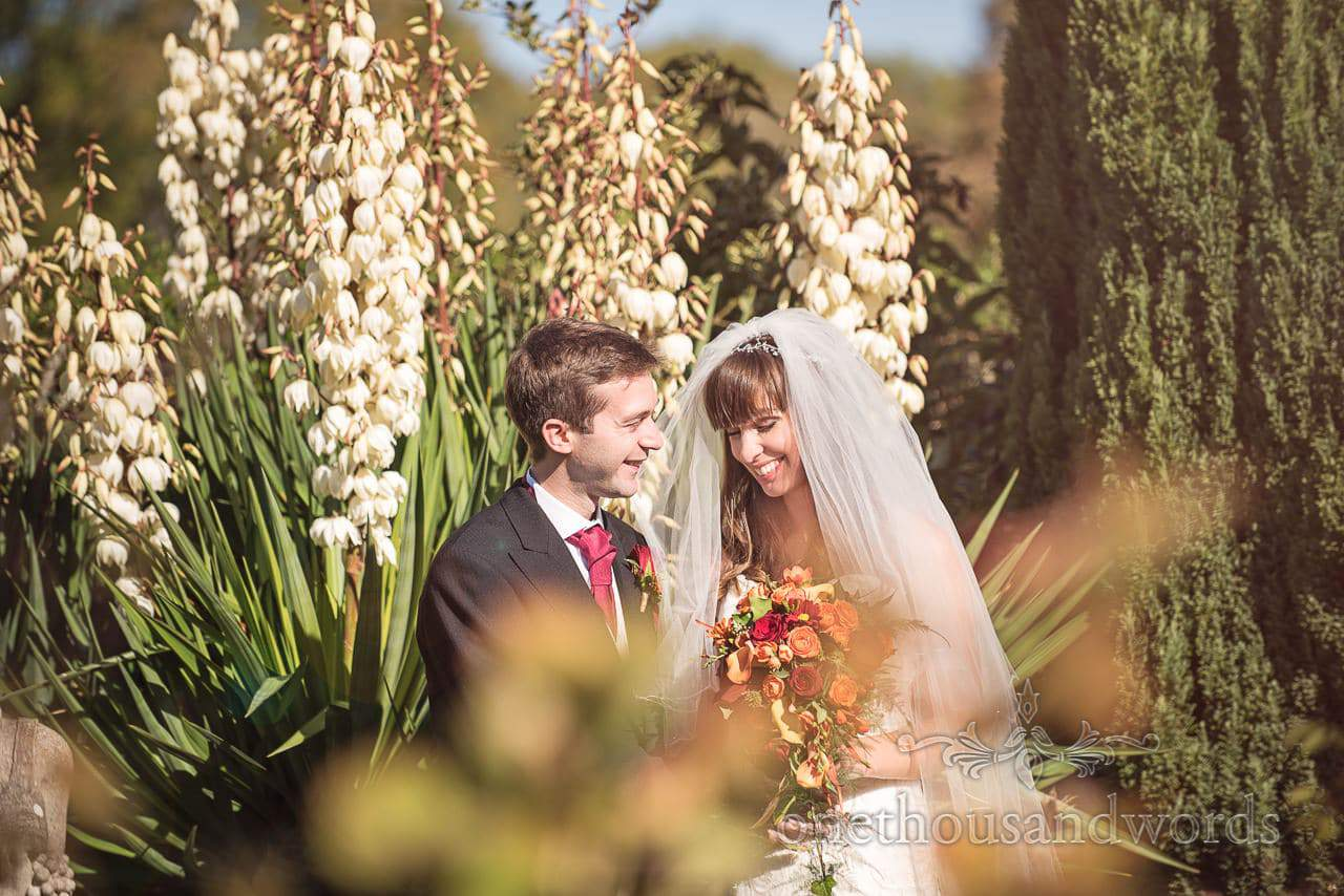 Bride and groom in flower gardens at Hethfelton House Wedding venue