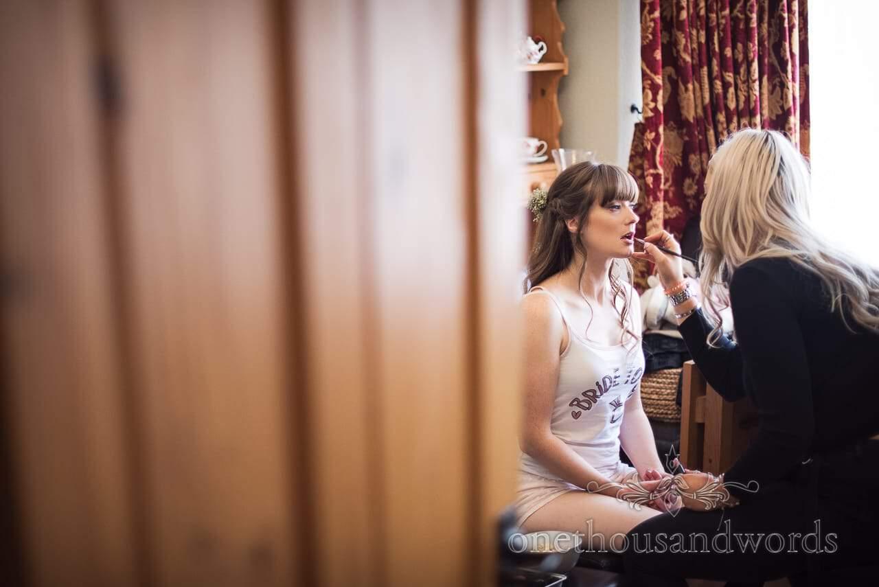 Bride had lips painted on morning of woodland Lulworth Castle wedding