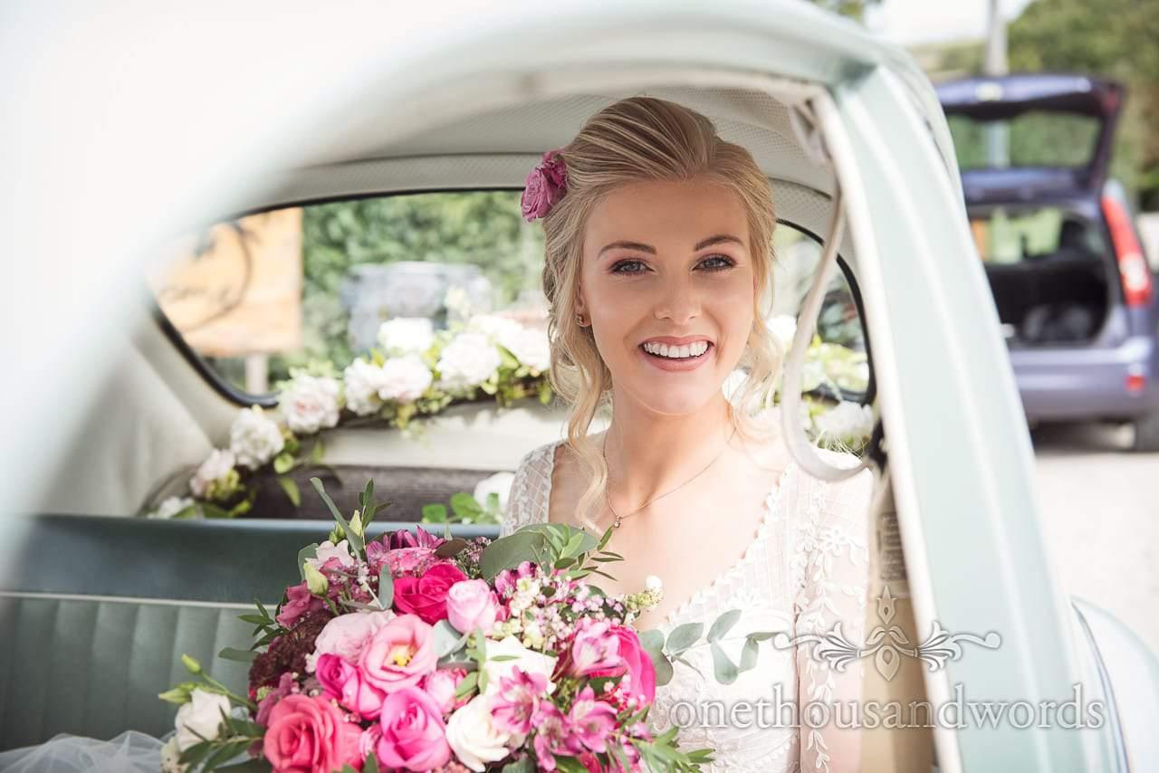Bride in classic VW beetle before Italian Villa wedding