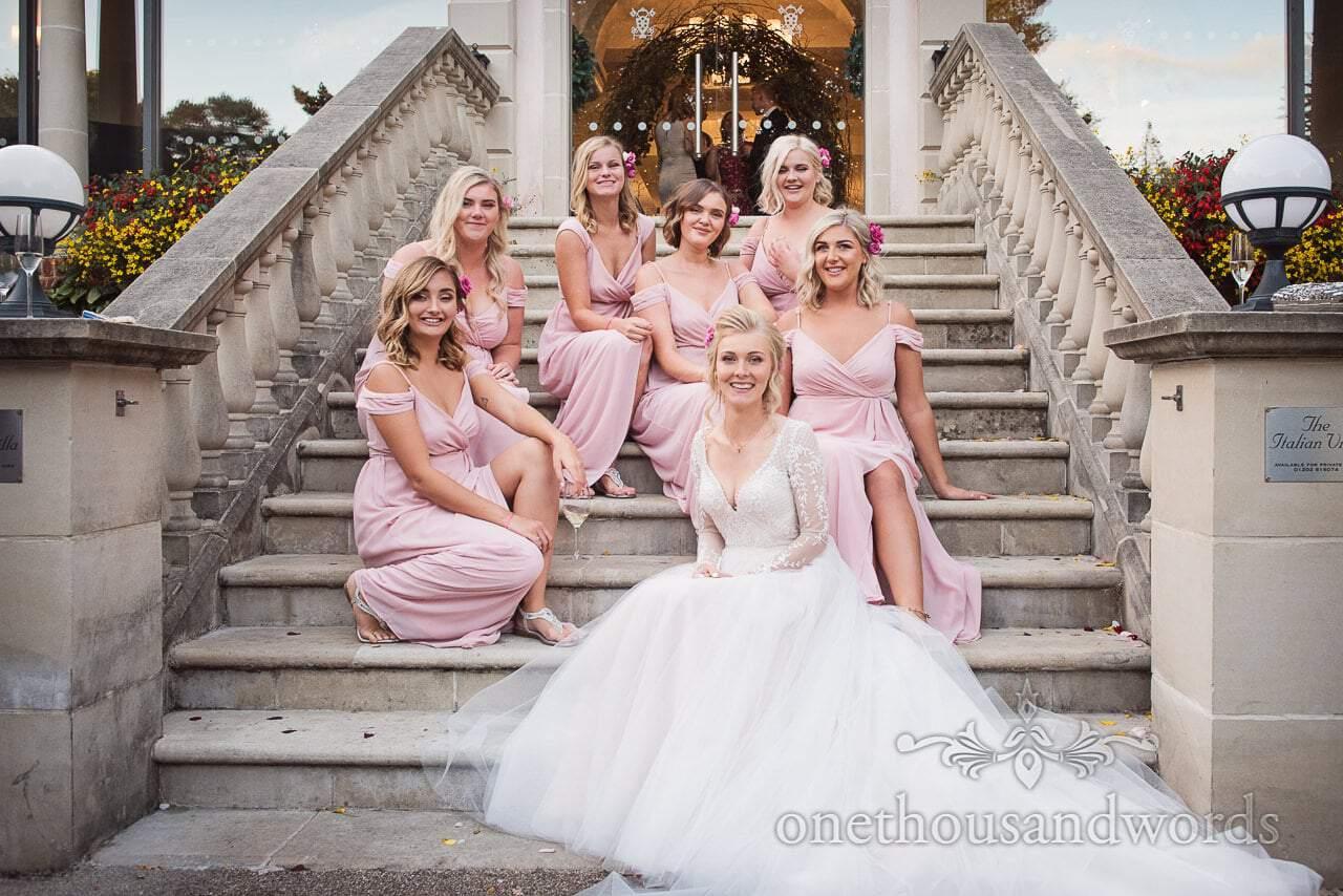 Bride poses with her bridesmaids at Italian Villa wedding