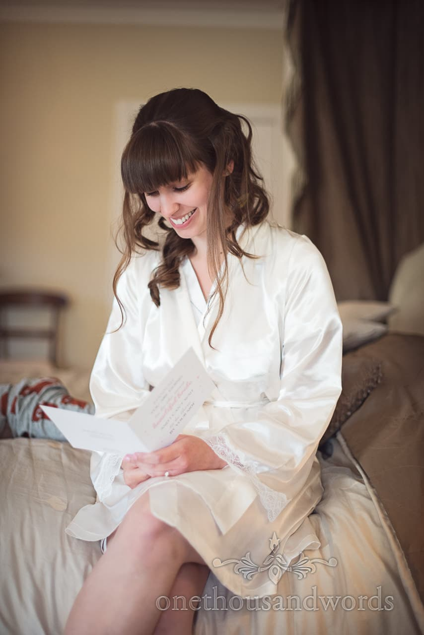 Bride reads love letter from groom on wedding morning in Dorset
