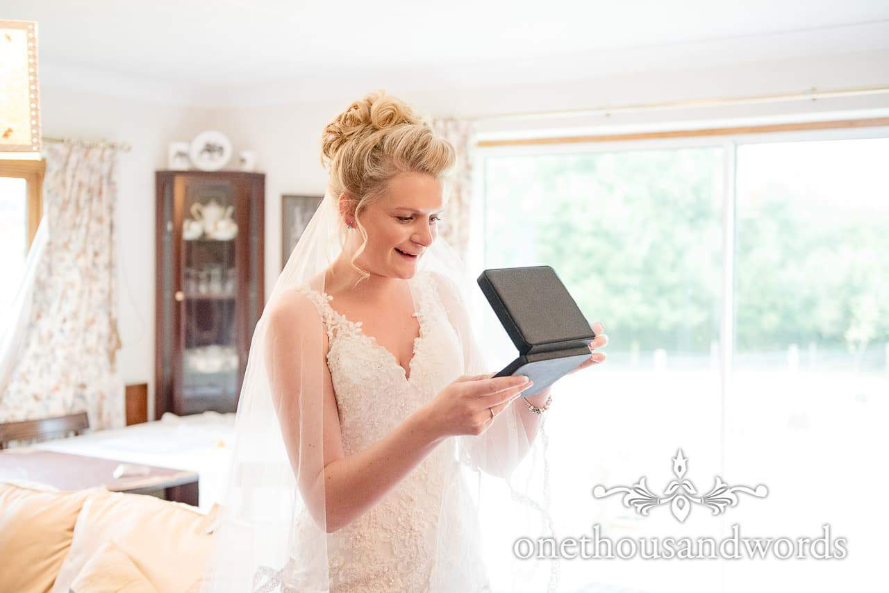 Bride receives necklace gift on wedding morning