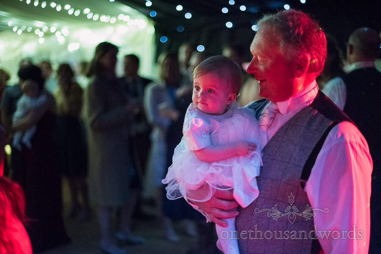 Brides father and flower girl on the dance floor in wedding marquee