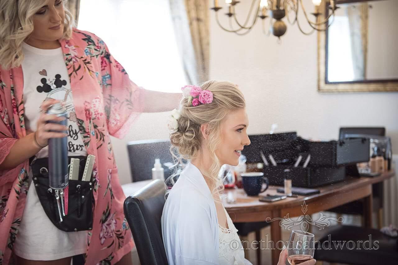 Brides hair is sprayed during morning of Italian Villa wedding
