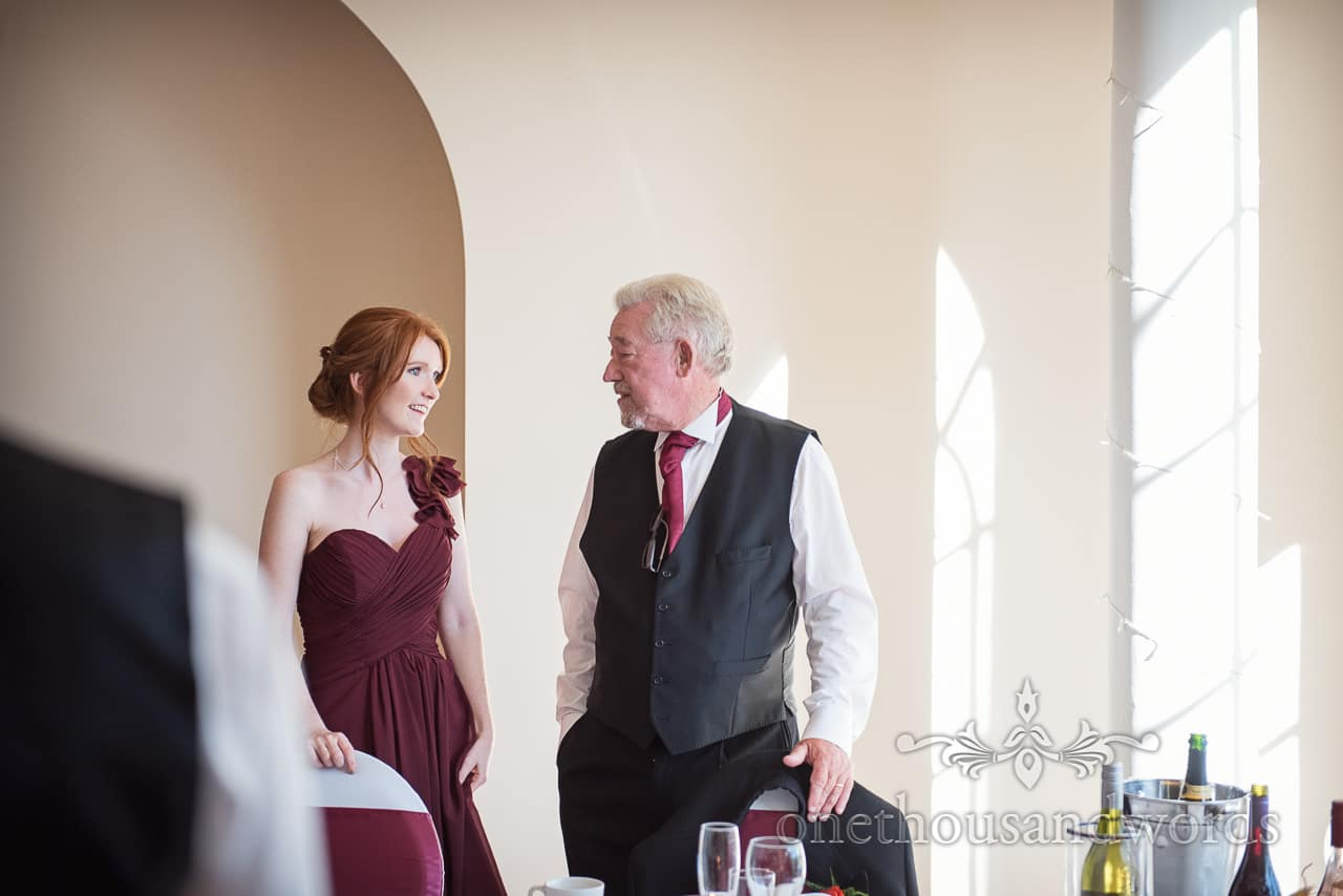 Bridesmaid and father of the bride talking at Hethfelton House Wedding