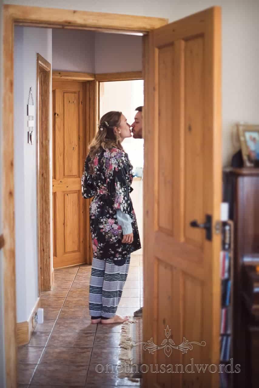 Bridesmaid steels a kiss on morning of woodland Lulworth Castle wedding