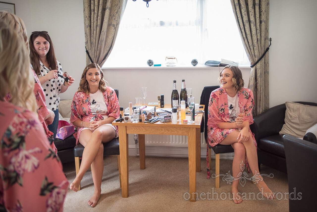 Bridesmaids in pink floral dressing gowns on morning of Italian Villa wedding