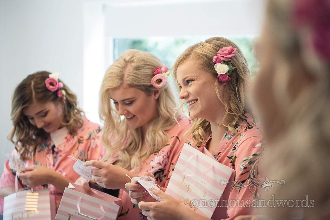 Bridesmaids receive gifts from bride on wedding morning