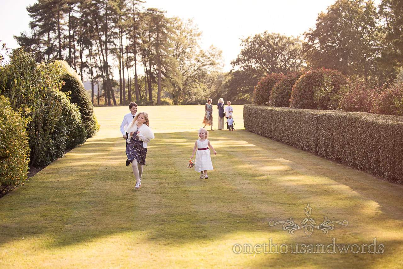 Children play on the lawns at Hethfelton House Wedding venue