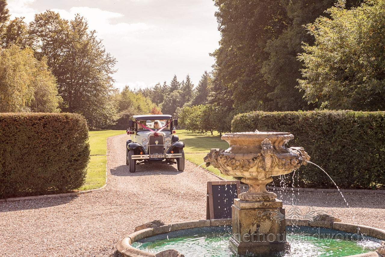 Classic wedding car arrives at Hethfelton House Wedding venue