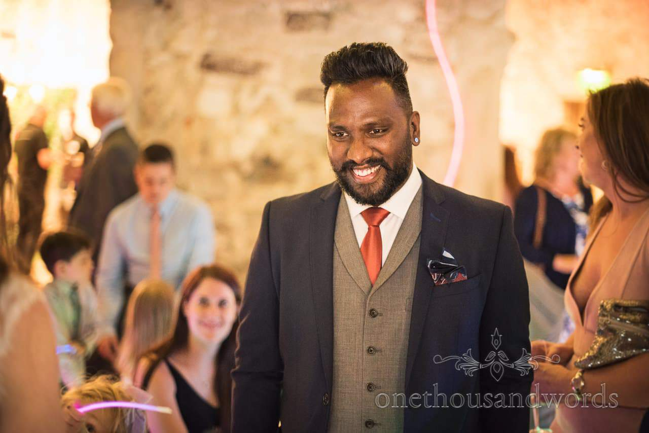 Dapper wedding guest with moustache photograph at Lulworth Castle Wedding