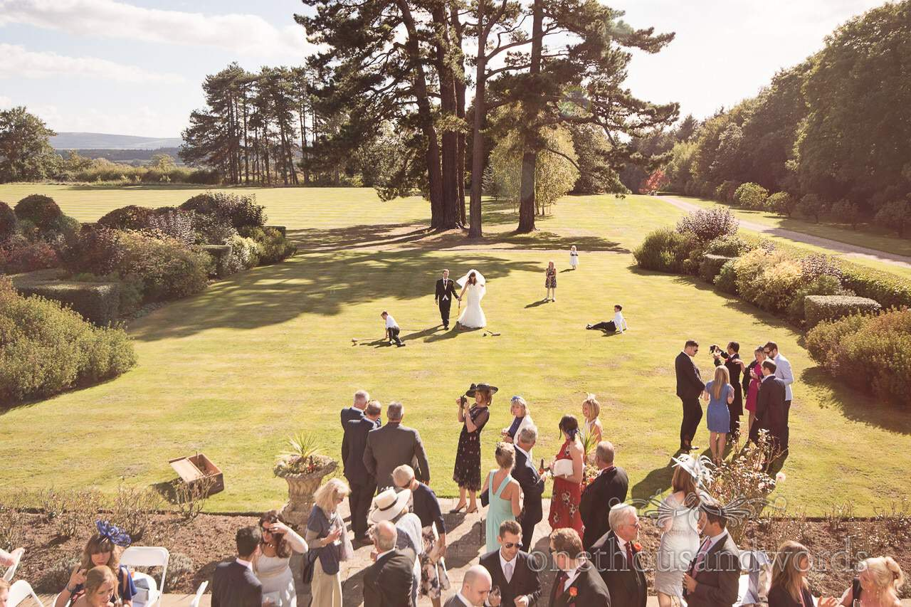 Drinks reception in the sun at Hethfelton House Wedding Photographs
