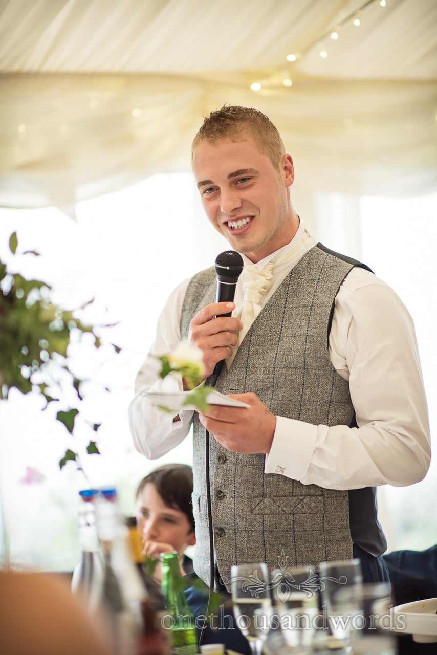 Farm marquee wedding photos of best man delivering speech