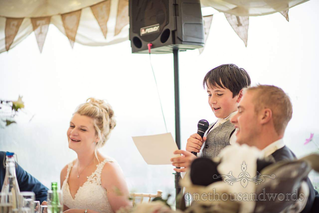 Farm marquee wedding photos of brother of the groom delivering speech