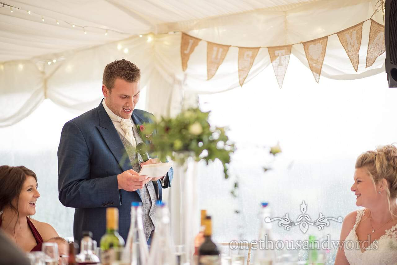 Farm marquee wedding photos of groom delivering speech