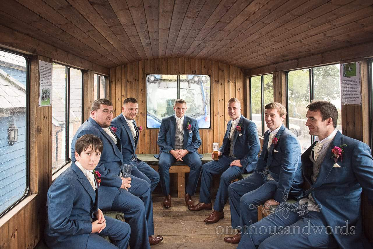 Farm marquee wedding photos of groomsmen on route to church