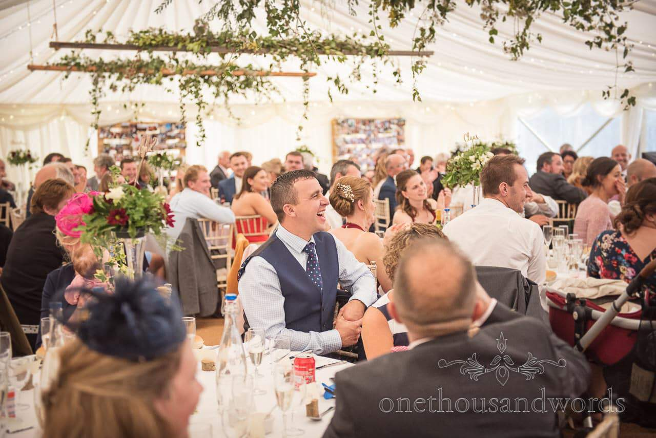 Farm marquee wedding photos of guests reaction during speeches