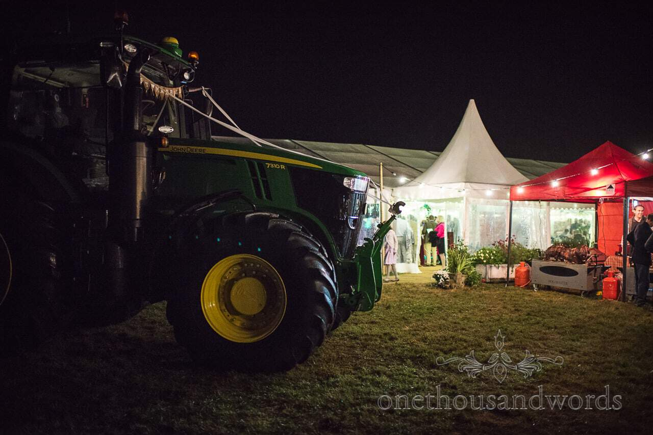 Farm Marquee Wedding Photos of John Deere tractor outside wedding at night