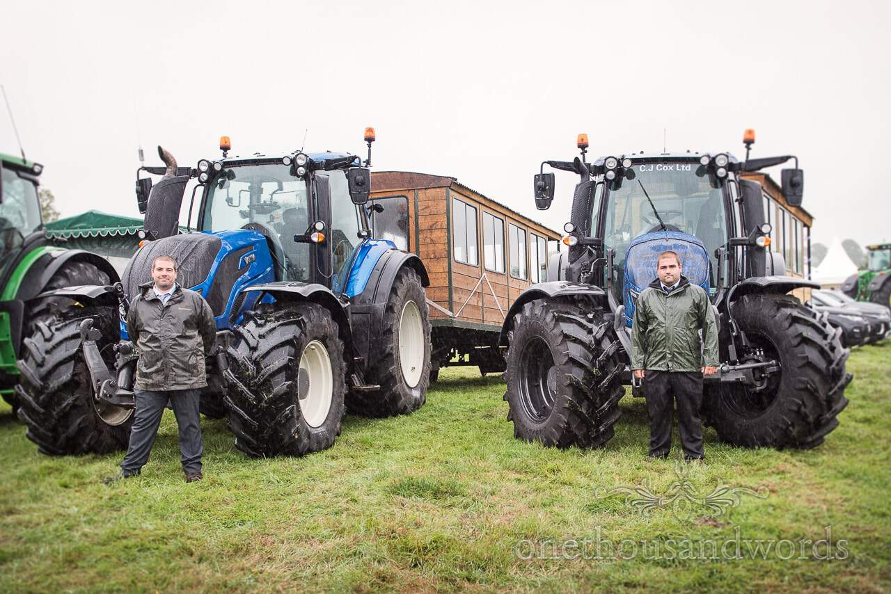 Farm marquee wedding photos of proud tractor drivers pose in rain