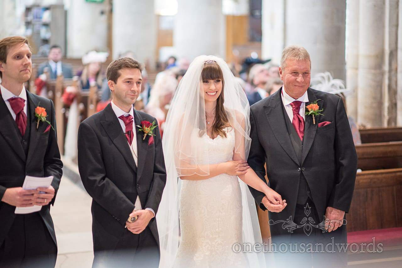 Father of the bride gives away daughter in Wimborne Minster wedding