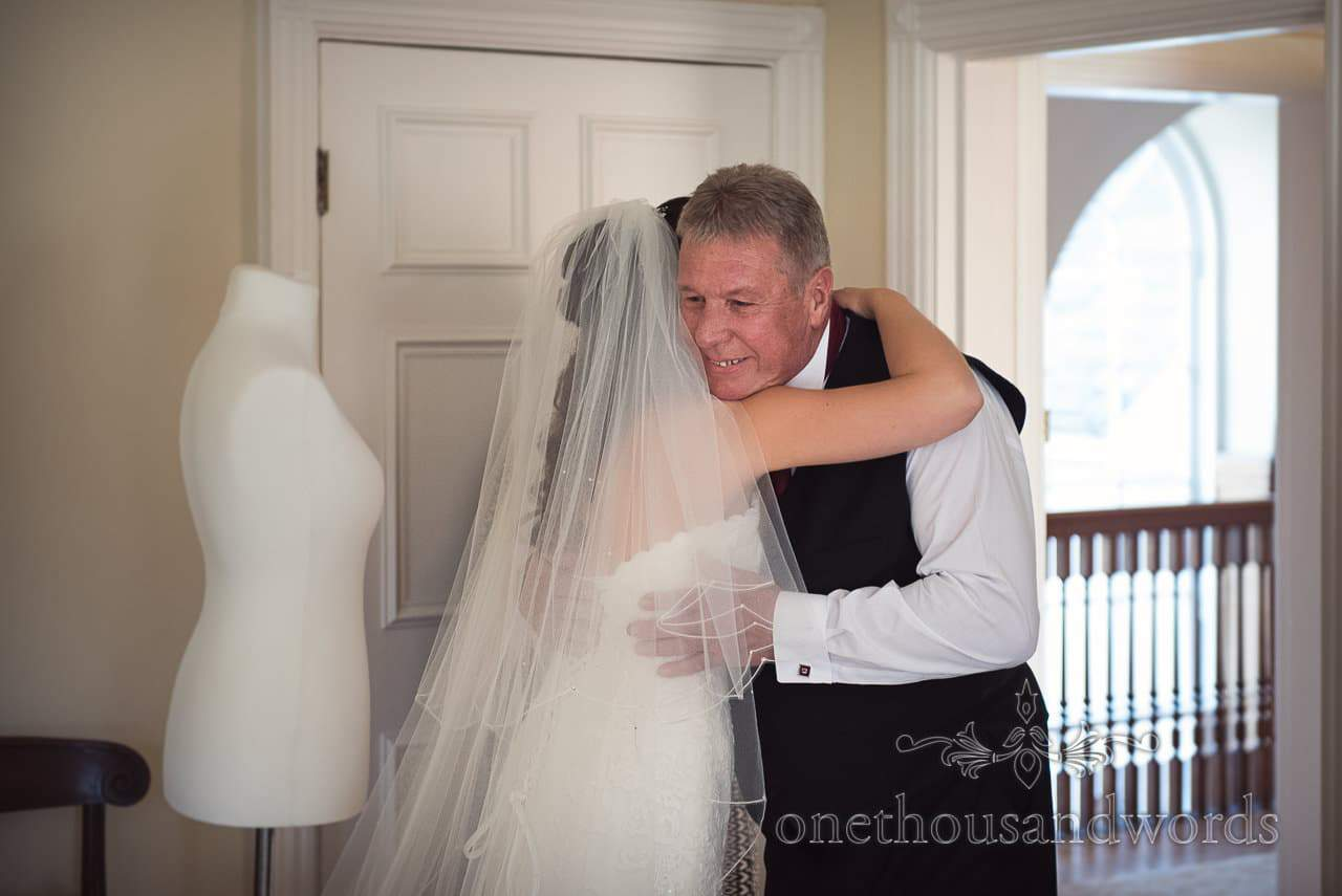 Father of the groom hugs bride on Hethfelton House Wedding morning