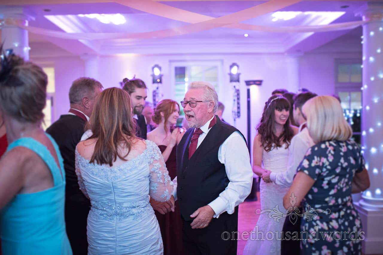 Father of the bride singing on dance floor at Hethfelton House Wedding